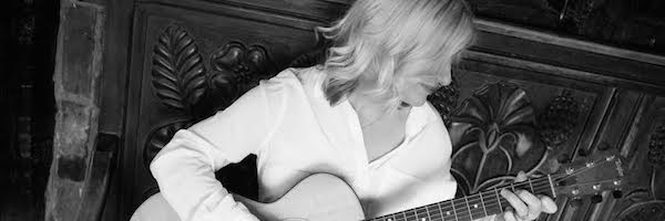 Lucinda with Guitar
